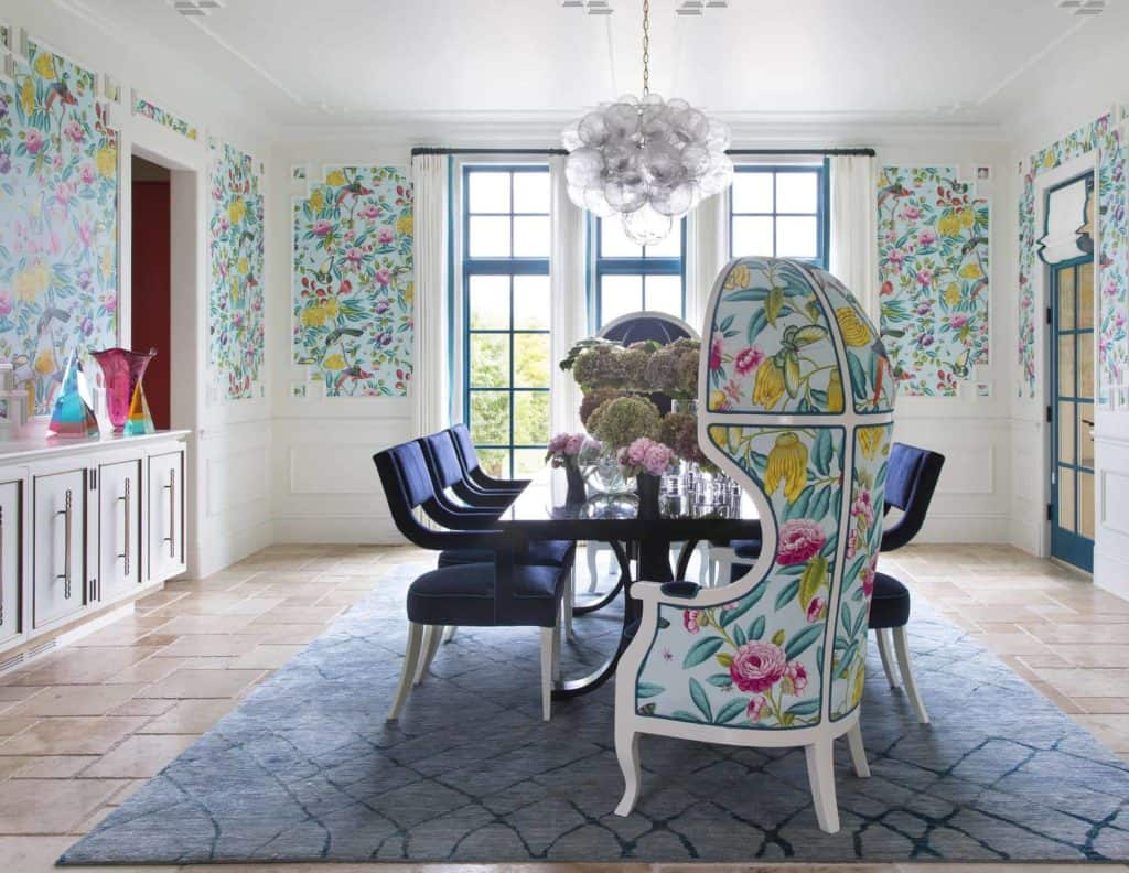 Bright floral wallcovering with custom dining furniture
